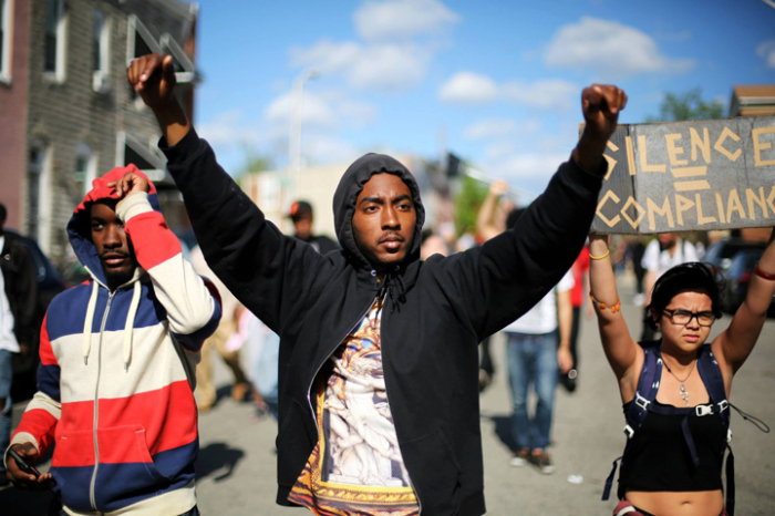 protester-does-the-iconic-22hands-up-dont-shoot-pose-while-marching-through-baltimore